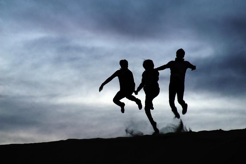 3 kids jumping